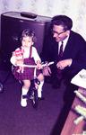 Dreirad und Puppe