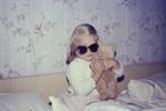 Sonnenbrille und Teddy