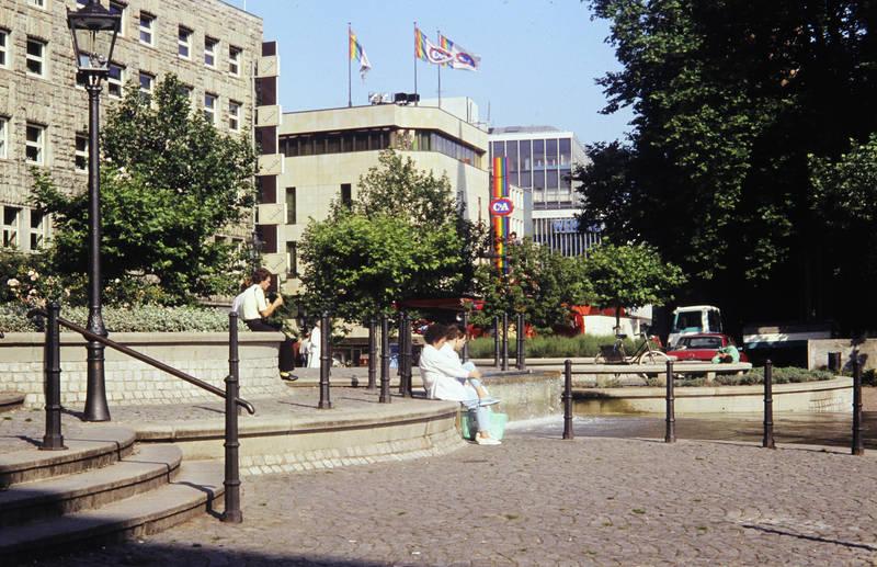 Brunnen, burgplatz, C und A, essen, fahne, fahrrad, kettwiger straße, loose, loosen, Reklame, Sonne, Wertheim