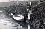 Frau mit Boot