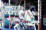 Kind im Karussell